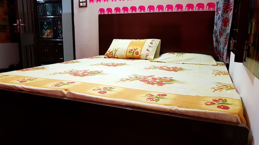 King sized wooden polished Bed with medicated mattresses