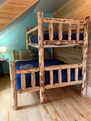 The Loft beds with a queen/ twin log bed combo