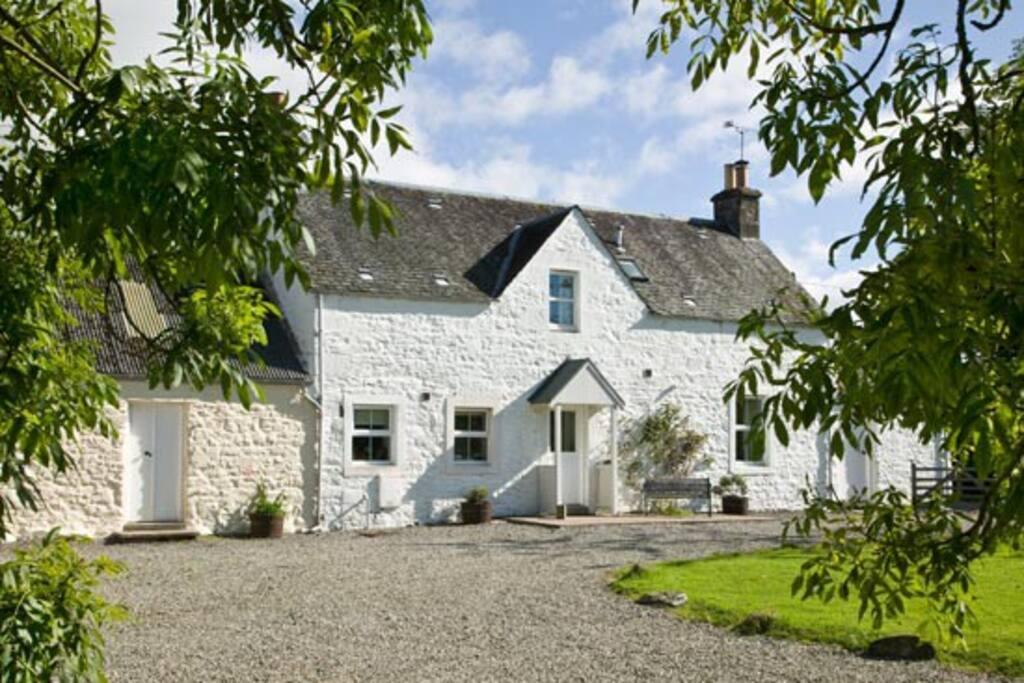 Arnvicar Cottage through Ash leaves