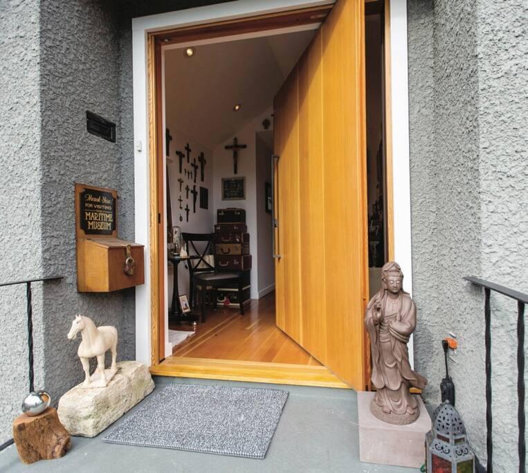 A solid fir door that pivots open...