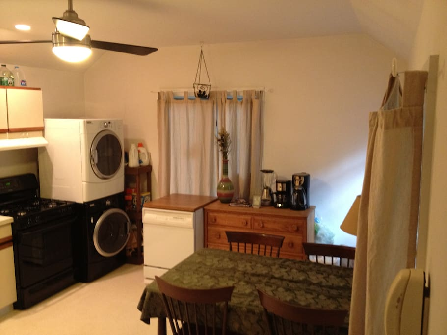 Kitchen with washer dryer and dishwasher