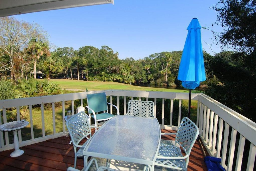 Rear deck overlooking lagoon and golf course
