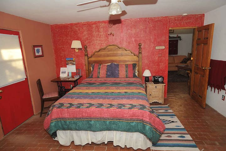 Tortugas room has a foam mattress and opens to the common living room, private patio and en-suite bathroom.