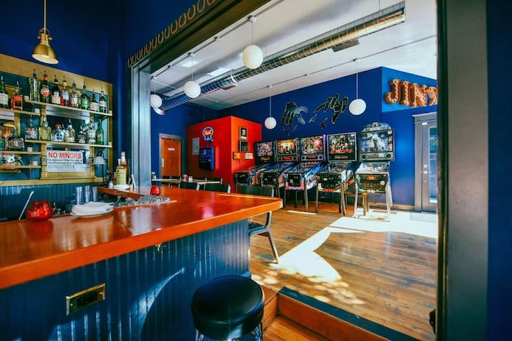 Grab a drink and play some pinball at JINX, a cozy tavern just a block away!