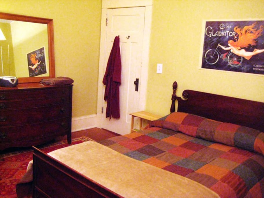 "The guest room (next to the dining room) has a queen size bed with a 1.5"" memory foam mattress topper."