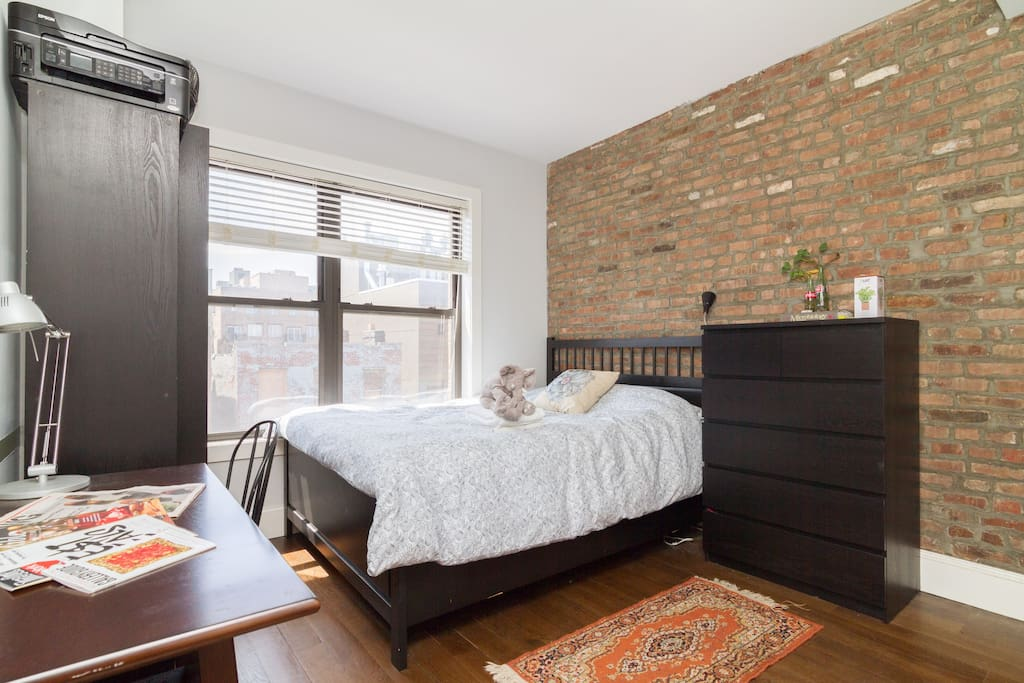 Spacious Master Bedroom with Queen Bed, Exposed Brick and Tons of Natural Lighting