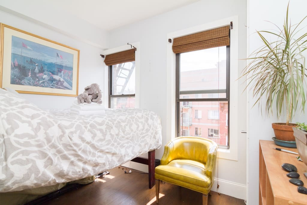 Cozy Nook, Bright room with natural light, slightly lofted bed to allow for storage of luggage.
