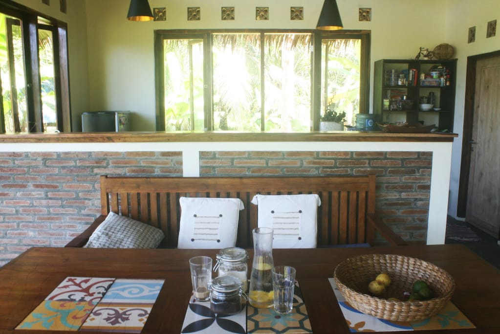 An open dining area and a fully equipped kitchen let you make you feel home