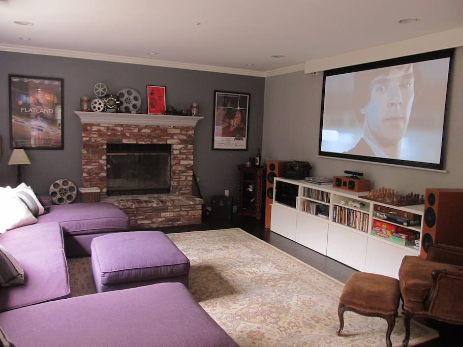 Den and home theater room with state-of-the art HD projector and surround sound system