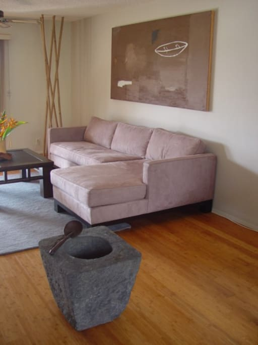 Contemporary and comfortable furnishings with bamboo floors.
