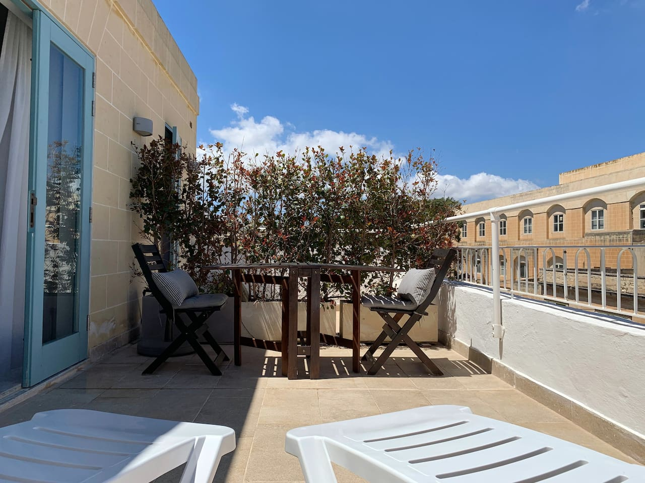 This is your private penthouse terrace - perfect for sunbathing and dining, with views of the area.