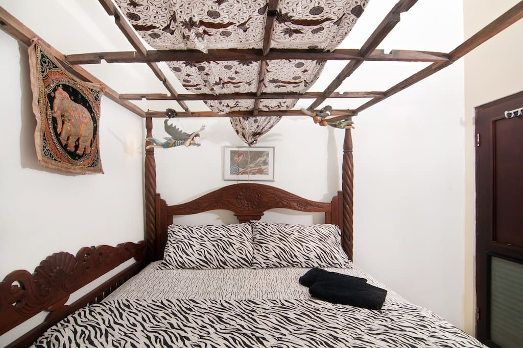 The small guest room with the spacious queen size bed