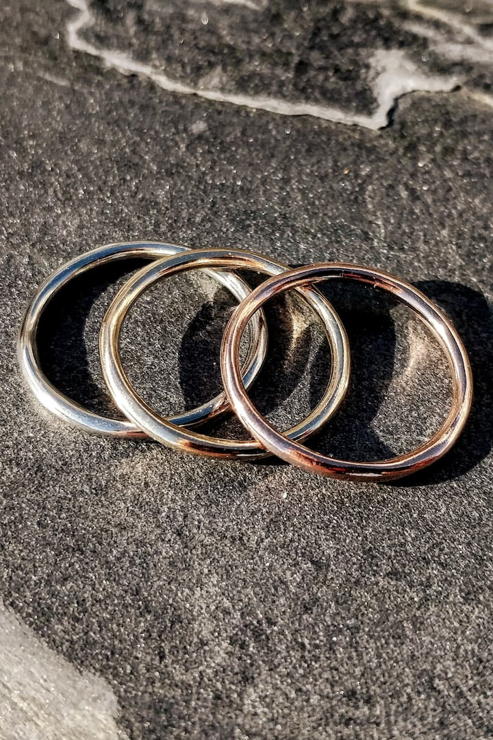Finished solid gold halo rings