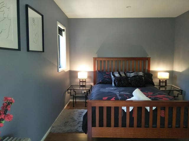 Bedroom 1 with queen size bed and tv