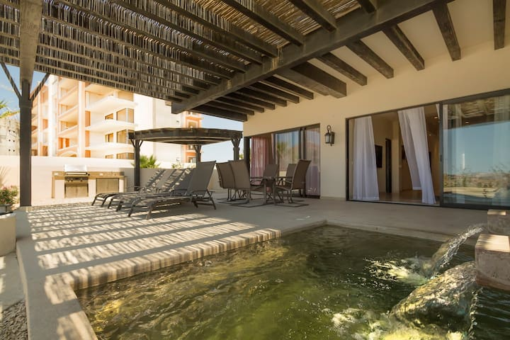 The covered outdoor area includes a large dining table, 6 chairs, 4 lounge chairs, BBQ grill and private splash pool
