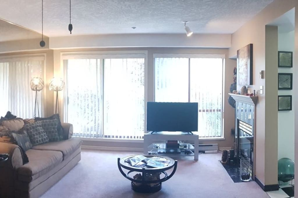 Living room, rearranged furniture and new tv! 9am and sunshine!