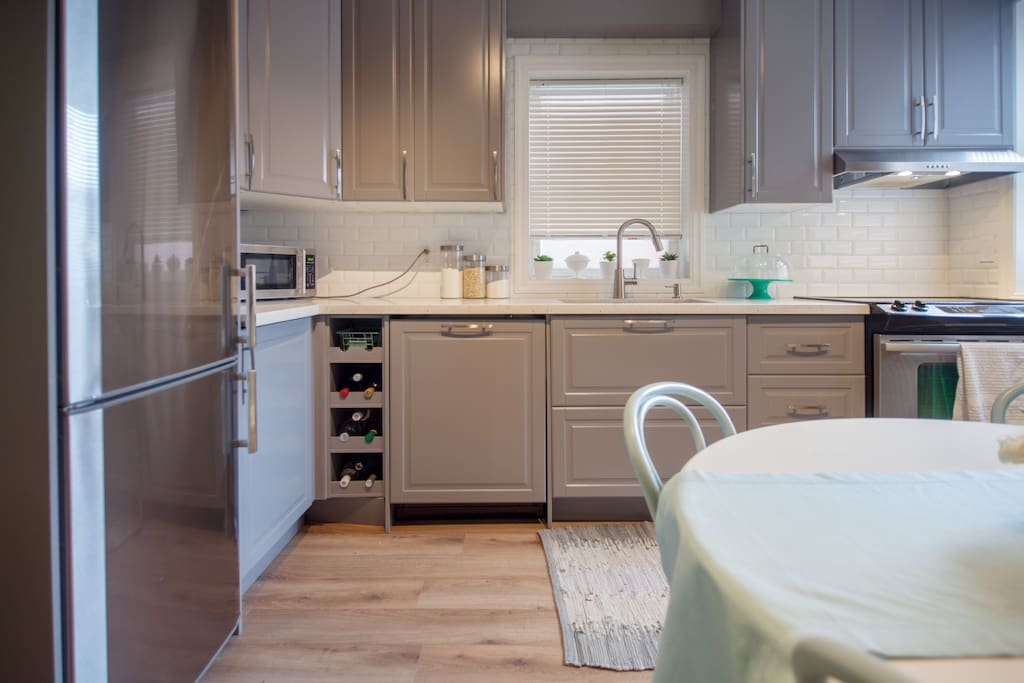 Open Kitchen with fridge, microwave, dishwasher, stove and oven