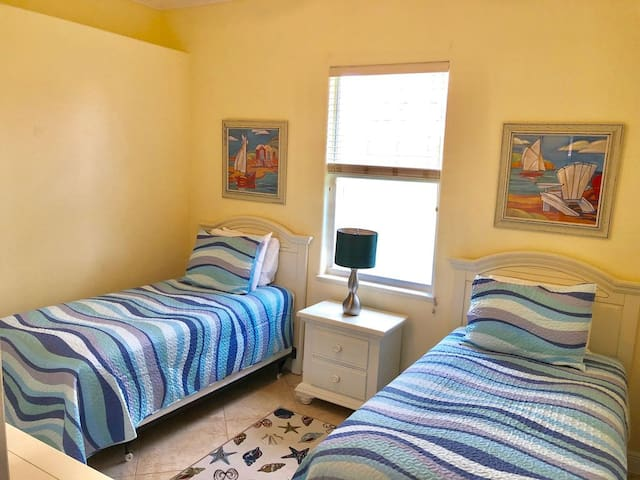 Twin bedroom number 2 with two twins, Smart TV and closet with built ins