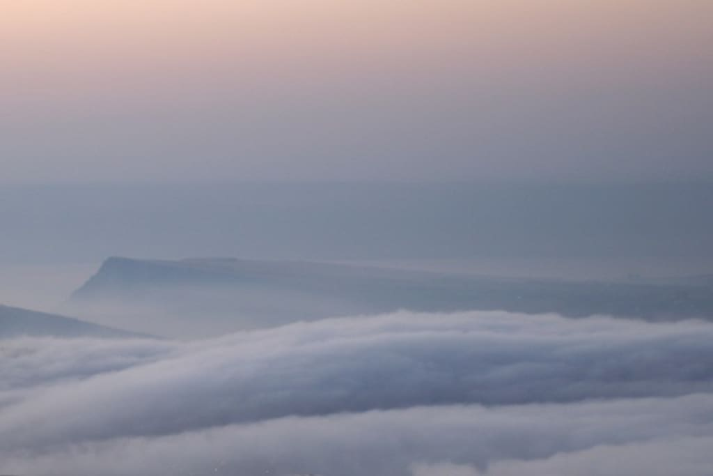the clouds are covering the vally below-the cliff above sea of Galilee