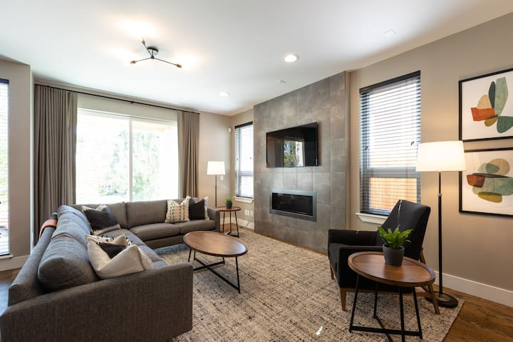 """Natural gas fireplace and 55"""" TV with Netflix, Hulu, and cable."""