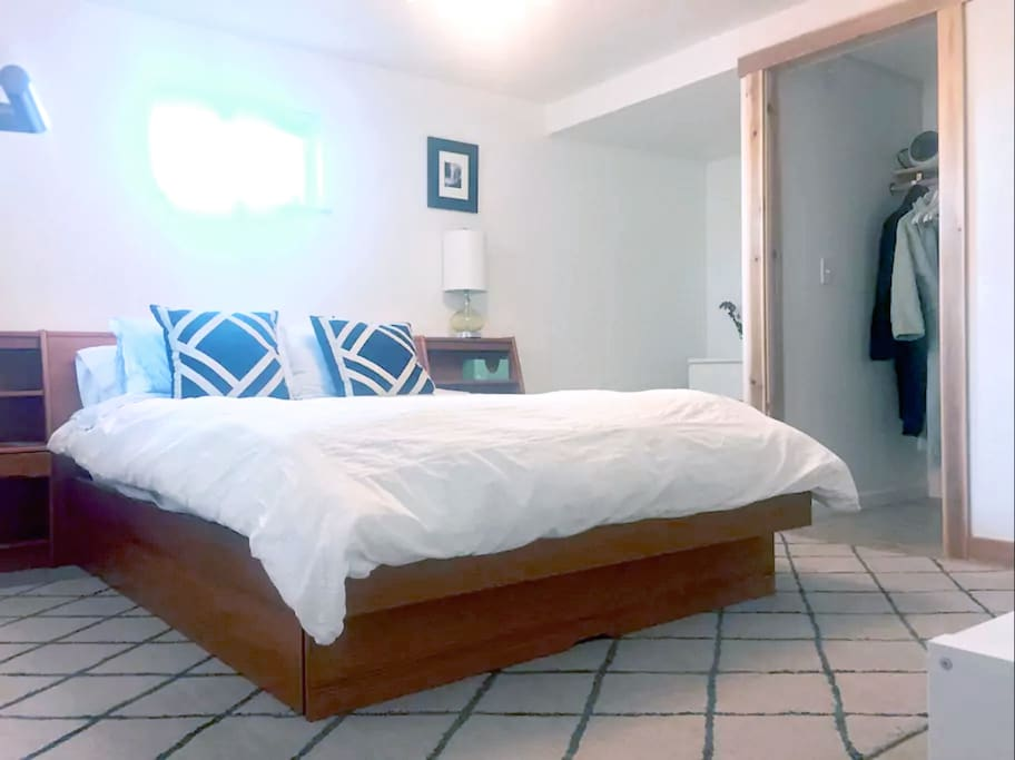 Master bedroom that gets ton of light with queen size bed and great linens.