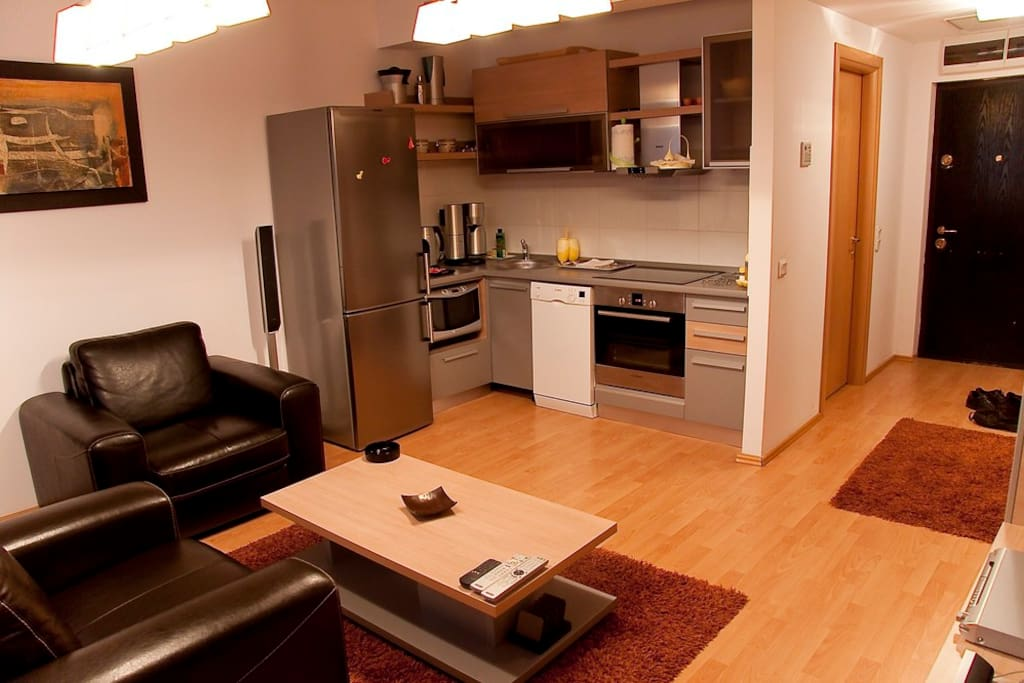 Kitchen - completely  equipped with  cooking stove, hood, microwave oven, toaster, coffee maker, refrigerator, dishwasher machine
