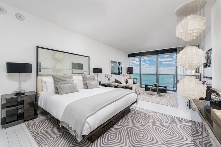 Relax on your dreamy bed at the W South Beach and watch the ocean waves billow on to the pristine sandy beach while you sip on a glass of wine.