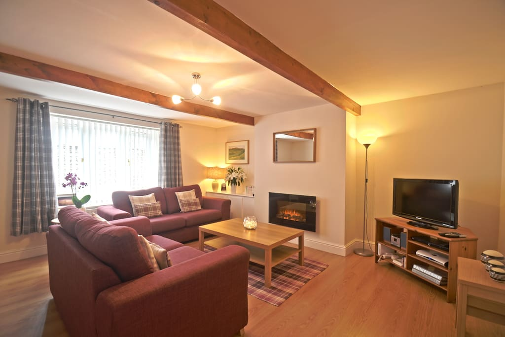 "The Living Room is incredibly spacious with two large sofas, 32"" LCD TV and Dining Area"