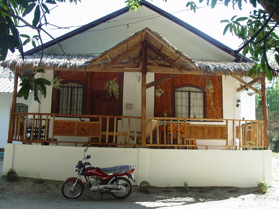 the sawlli house front side. the walls made half of sawalli which is bamboo.