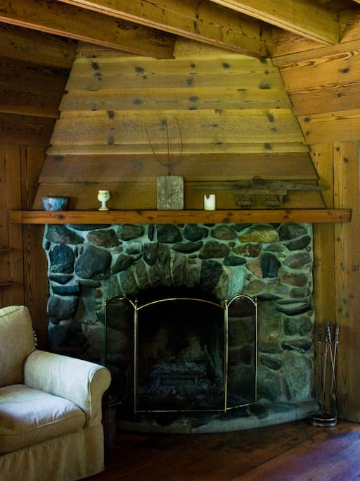 living room fireplace with amazing hand place stones. a favorite gathering spot for early mornings, and cooler evenings. everyone loves to enjoy a fire here.