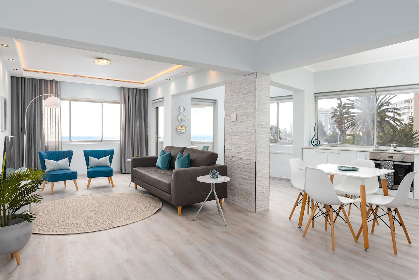 Contemporary open plan bright and airy living area providing spectacular sea views from all windows.