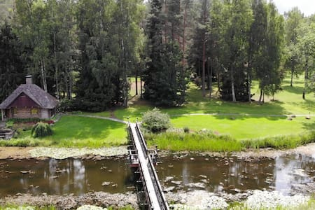 Log Cabin, Kuldiga.  Избушка у пруда, Кулдига.