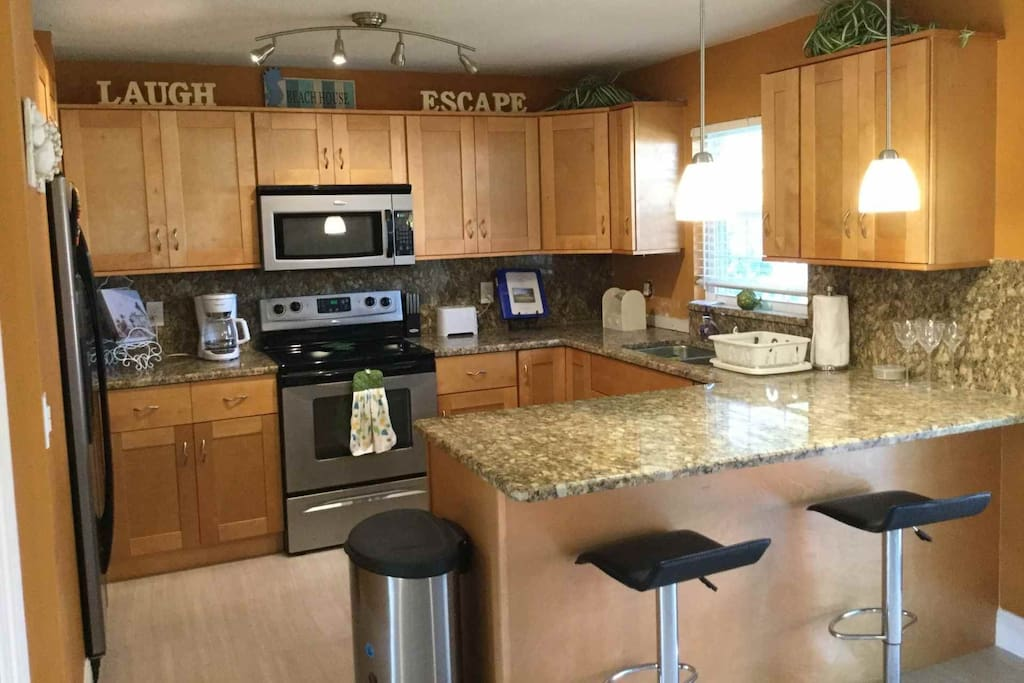 Beautiful and contemporary kitchen complete with stainless steel appliances.