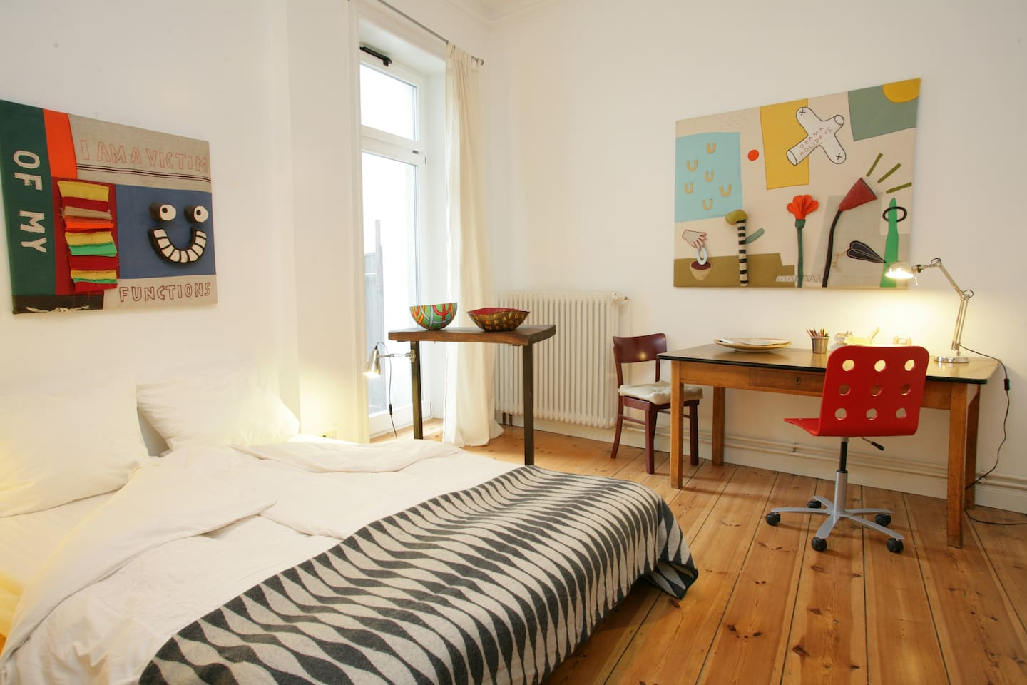 double bedroom with door to small private terrace