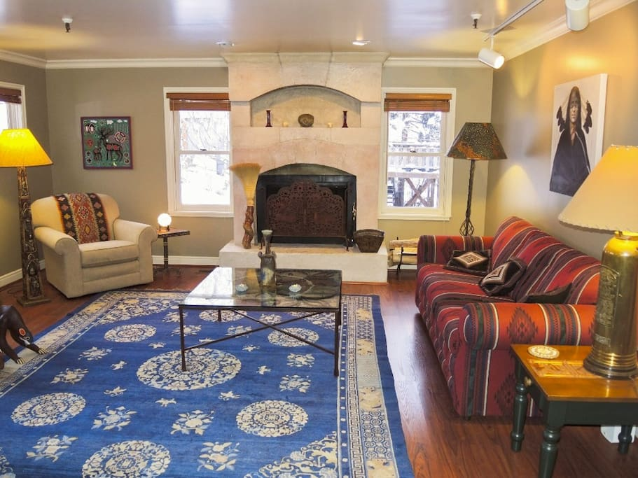 The charming living room has ample seating for guests