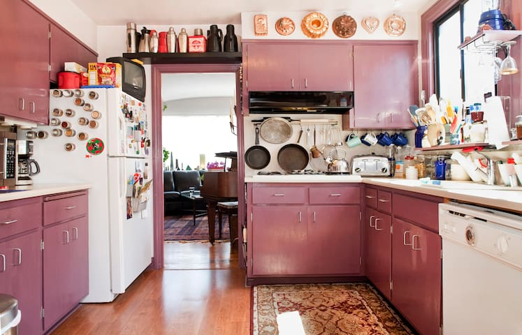 Our kitchen, stocked with plenty of appliances, cooking tools, and pots and pans for your use...