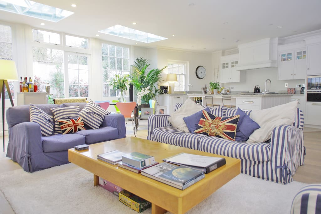 The living room offers a feeling of space, comfort and luxury for you to enjoy, with an abundance of natural light and doors to a spacious garden
