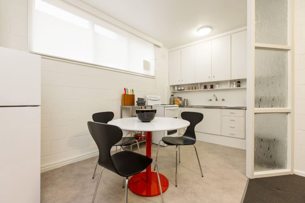 spacious dining for 3 and full size kitchen