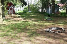 The front of the cottage also has a swing and fire pit