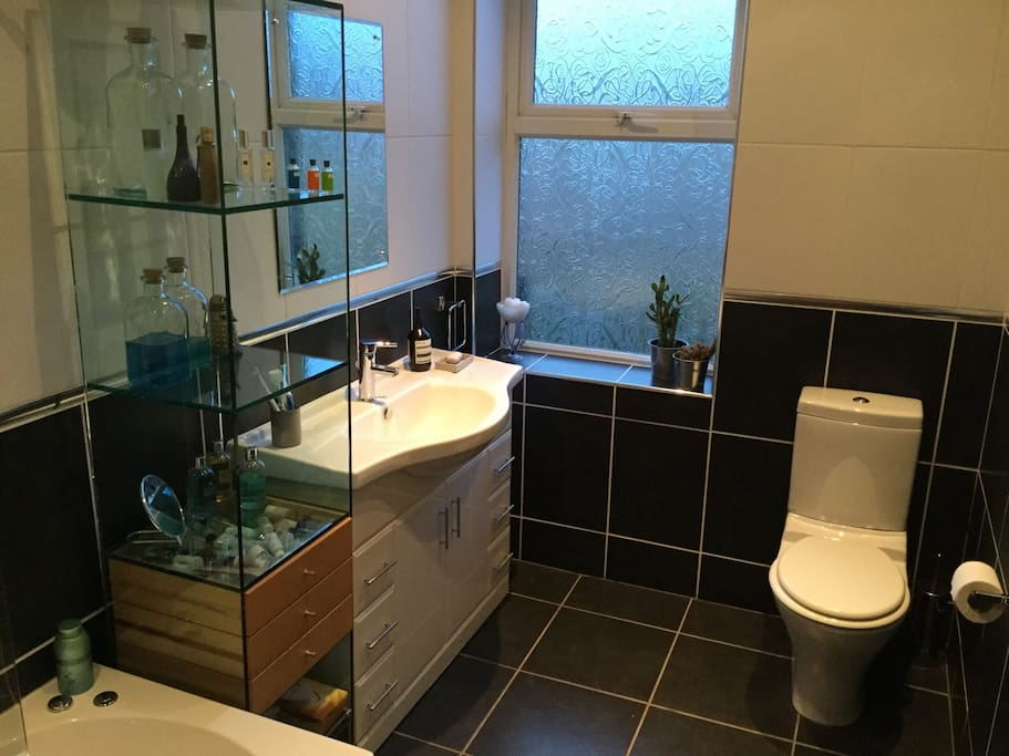 Modern and well equipped bathroom next to bedroom, almost exclusively for guest use
