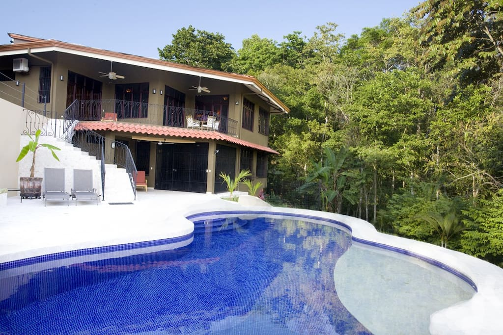 View from the deep end of the pool looking at the house. Owners lower suite below.. occupied Nov to April.