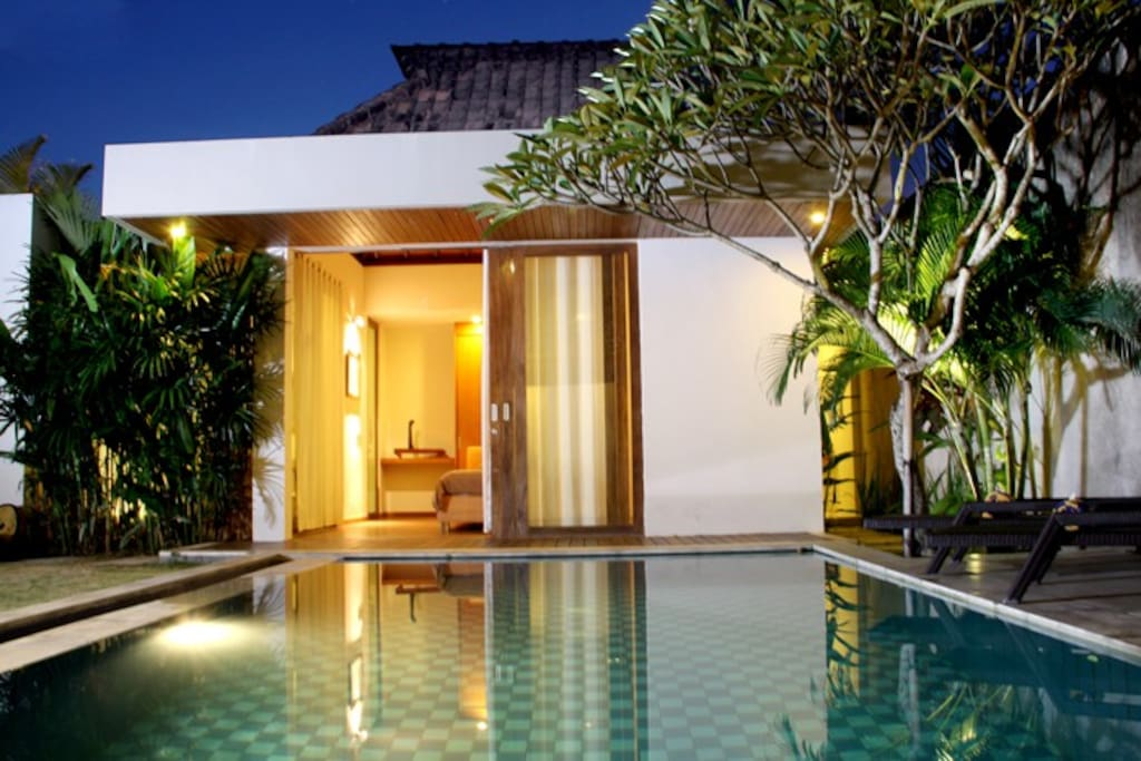 Master Bedroom with Swimming Pool at Night.