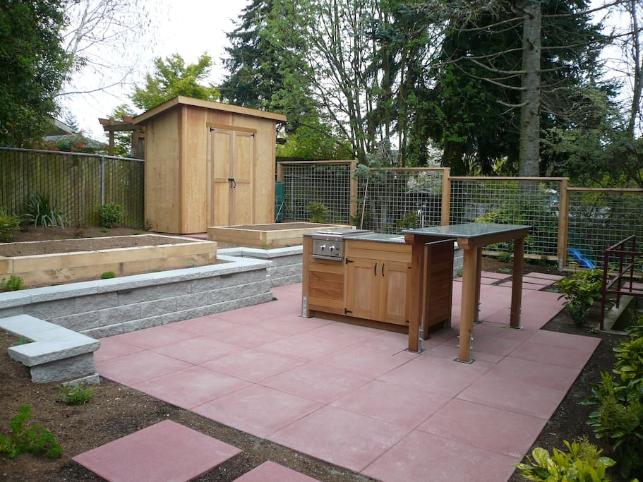 We remodeled our patio area -- low bench walls act as seating, bar benches coming, outdoor sink...