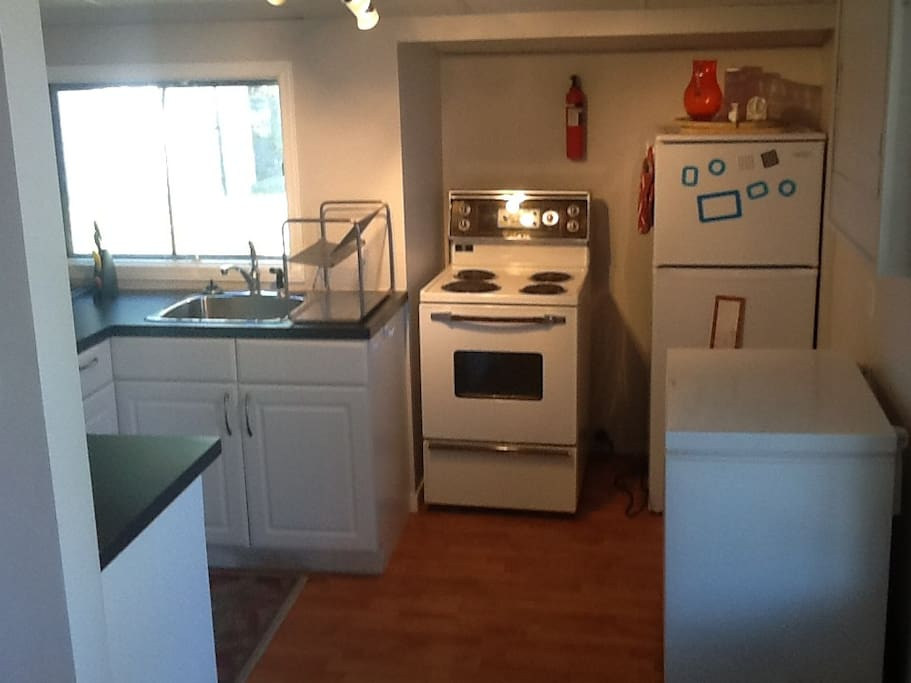 Kitchen with Range/Stove, Fridge, Freezer