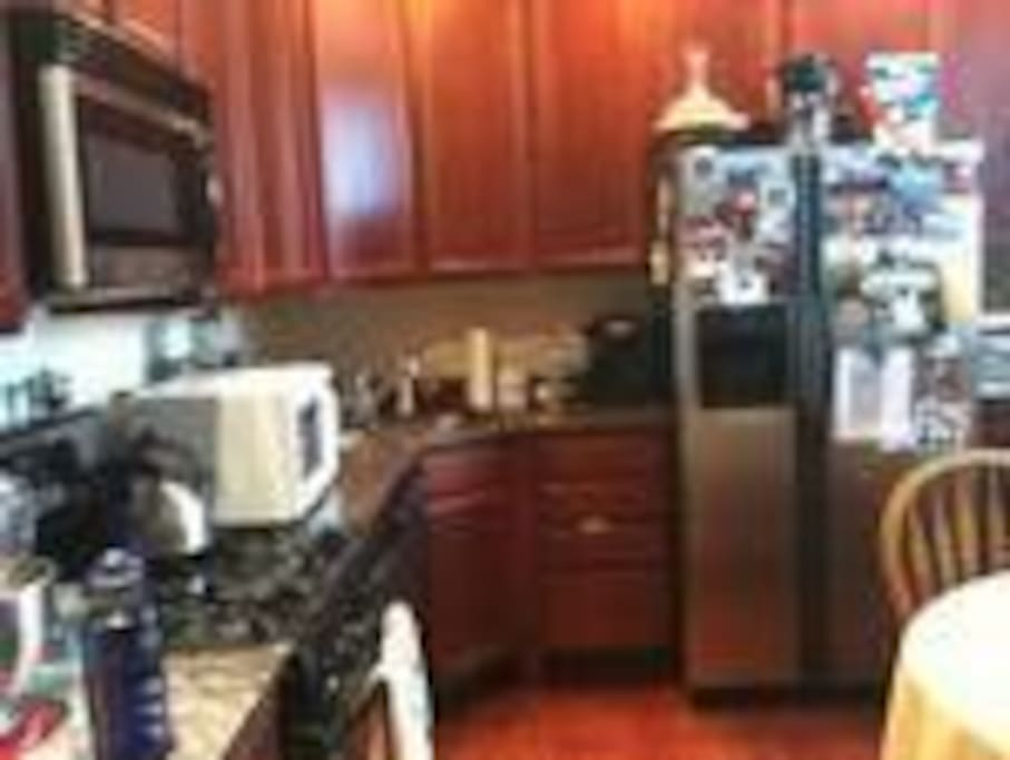 kitchen with stainless steel appliances, marble countertops