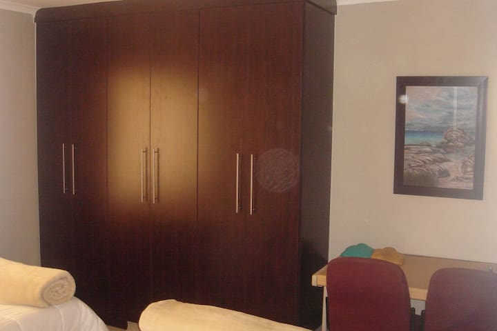 Twin room wardrobe and desk.