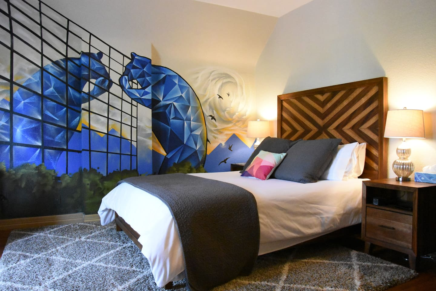 A VERY comfortable bed with the Big Blue Bear seeing his reflection at the Convention Center. Mural by renowned Denver artist Chad Bolsinger. RiNo art walk is just blocks away!