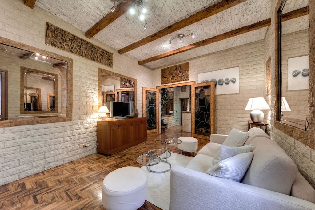 Living room,+double bed sofà+air conditiong/heater, tv, table for lunch or dinner