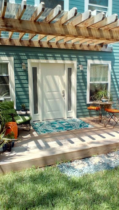Front porch and entry with cafe table and rocker.