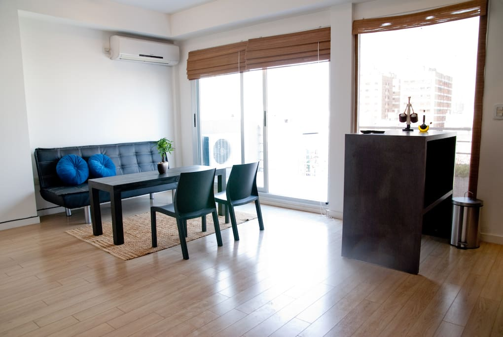 open living area, this has been further equipped with some beautiful stools and a full dining table!